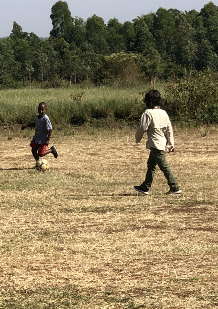"Playing a friendly game of ""football"" on the airstrip!"
